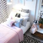 Poduszki, zasłony, chorągiewki Dots My Love. Lampka Spot Light. Łóżko Ikea. Szczyt łóżka projektu Doroty.