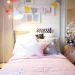 Poduszki i chorągiewki Dots My Love. Lampka Spot Light. Łóżko Ikea. Szczyt łóżka projektu Doroty.